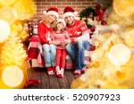 family with christmas gift.... | Shutterstock . vector #520907923