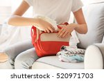 woman packing her bag with...   Shutterstock . vector #520971703