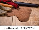 leather in rolls and shoe lasts ... | Shutterstock . vector #520991287