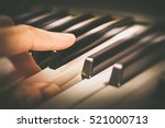 male musician fingers playing... | Shutterstock . vector #521000713