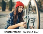 young woman repair bicycle....   Shutterstock . vector #521015167
