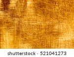 scratches on a metallic gold... | Shutterstock . vector #521041273