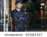 security man standing indoors | Shutterstock . vector #521061517