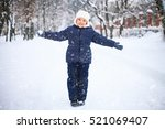 Small Girl Playing With Snow I...