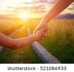 hands of mother and daughter... | Shutterstock . vector #521086933