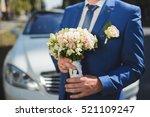 groom in blue suit with bouquet ... | Shutterstock . vector #521109247