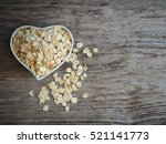 old fashioned rolled oats in... | Shutterstock . vector #521141773