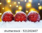 red christmas balls in the snow | Shutterstock . vector #521202607