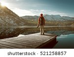 hiker on a jetty | Shutterstock . vector #521258857