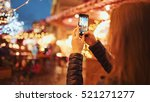woman taking pictures of... | Shutterstock . vector #521271277