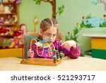cute little girl playing with...   Shutterstock . vector #521293717