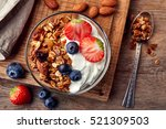 bowl of homemade granola with... | Shutterstock . vector #521309503