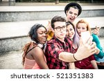 teens taking selfie with phone | Shutterstock . vector #521351383
