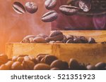 coffee beans while roasting hot ... | Shutterstock . vector #521351923