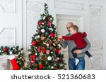 father and son are decorating... | Shutterstock . vector #521360683