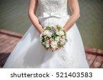 bride in white dress holding... | Shutterstock . vector #521403583