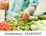 young woman buying vegetables... | Shutterstock . vector #521442937