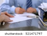 binders with papers are waiting ... | Shutterstock . vector #521471797
