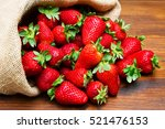 fresh strawberry in burlap sack ... | Shutterstock . vector #521476153