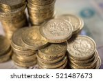 British Pound Coins Against A...