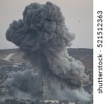 Small photo of Smoke rises after an US-led coalition air strike on Kobane, Syria, as seen from the Turkish side of the border, near Suruc district, Sanliurfa, Turkey, 18 October 2014.