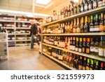 blurred image wine shelves with ... | Shutterstock . vector #521559973