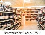 blurred image of wine shelves... | Shutterstock . vector #521561923