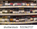 blurred image of wine shelves... | Shutterstock . vector #521562727