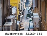 behind building in narrow alley ... | Shutterstock . vector #521604853