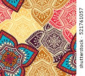 ethnic floral seamless pattern   Shutterstock .eps vector #521761057