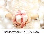 female hands holding christmas... | Shutterstock . vector #521773657
