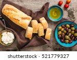 fresh italian baguette cut in... | Shutterstock . vector #521779327