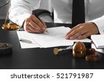notary public in office signing ...   Shutterstock . vector #521791987