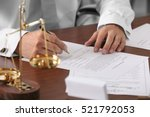 notary public in office signing ... | Shutterstock . vector #521792053