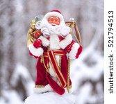 santa claus carrying sack full... | Shutterstock . vector #521794513