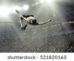 athlete in action of high jump. | Shutterstock . vector #521820163