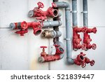 metal water pipes. red valves.... | Shutterstock . vector #521839447