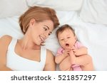 young mother and baby lying on... | Shutterstock . vector #521857297
