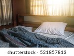 messy white bed  vintage filter. | Shutterstock . vector #521857813