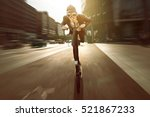 businessman on a scooter | Shutterstock . vector #521867233