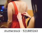 girl helping another girl to... | Shutterstock . vector #521885263