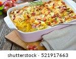 hearty potato gratin with... | Shutterstock . vector #521917663