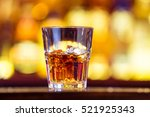 one whiskey with ice in a glass ... | Shutterstock . vector #521925343
