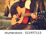 man playing guitar for girl on... | Shutterstock . vector #521957113