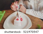 Small photo of girl eating big piece of cake in the restaurant. Office worker on lunch in a cafe. Closeup portrait of hands holding a fork, break off a piece of cake.