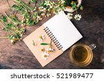 blank notebook white flower and ... | Shutterstock . vector #521989477