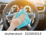 hand with microfiber cloth... | Shutterstock . vector #522003313