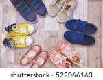 colorful kids shoes on floor | Shutterstock . vector #522066163