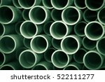 A Stack Of Pipes On A...