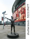 Small photo of LONDON, ENGLAND - MAY 04, 2012 : Tony Adams bronze statue located outside the North Bank End of the Emirates Stadium; home ground of Arsenal Football Club.
